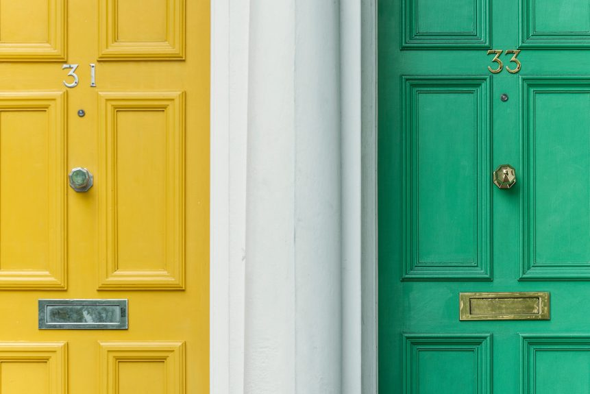 A yellow and green door next to each other